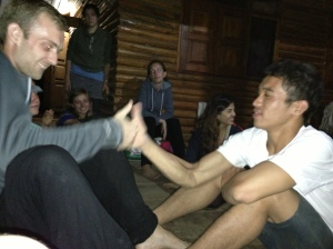 Singto thumb wrestling with one of the other volunteers.